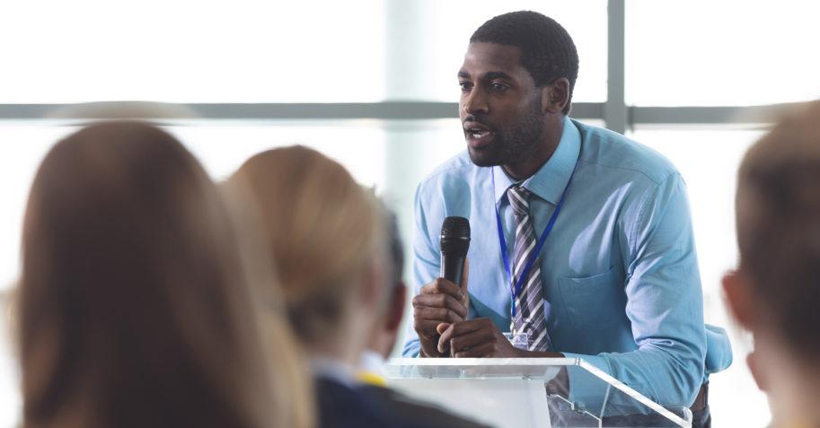 Chapel speaker ecouraging students in a Christian school