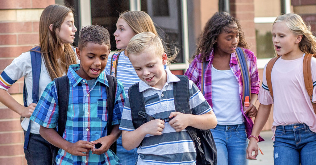 Group of diverse kids outside a Christian School