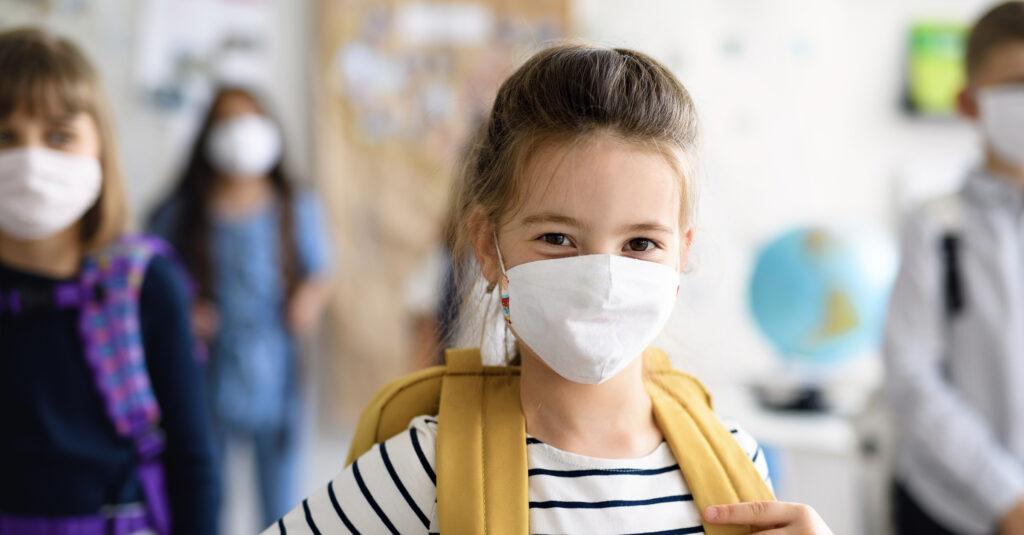 Masked Christian school students returning to school during the coronavirus pandemic.