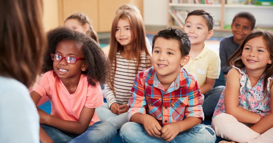 Diverse kids in a Christian Kindergarten classroom